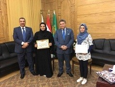 El-Kady hands the certificates of the Arab Universities trainees in Benha University
