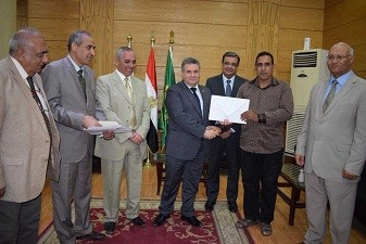 EL-Kady honors two workers in Benha University