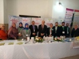 The university president inspects the faculties book fair