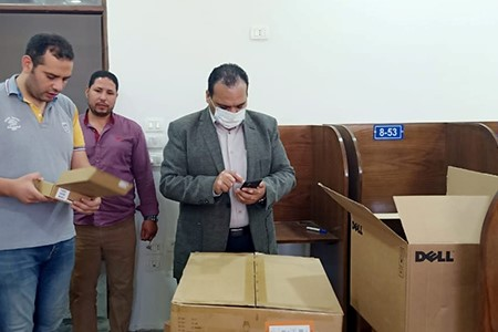 Tamer Samir inspects the Electronic Coordination Laboratories